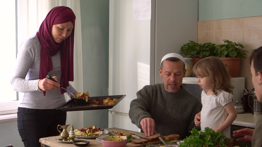 Ramadan Month. Arabic muslim family eating traditional Middle Eastern meals. The fast-breaking food at sunset Royalty-Free Stock Footage #1050408352