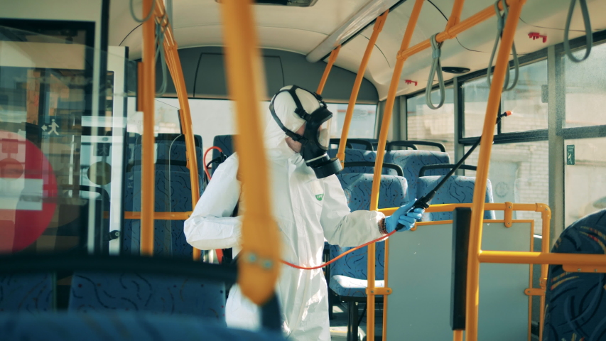 Bus interior is getting chemically sanitized by a specialist | Shutterstock HD Video #1050443023