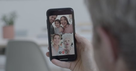 Family on video call at home during social distancing using smart phone and video conferencing technology