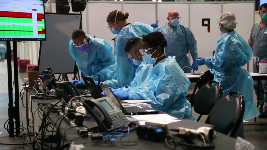 CIRCA 2020 - New York coronavirus Covid-19 intensive care doctors and nurses at workstation at the Javits Convention Center during the pandemic.