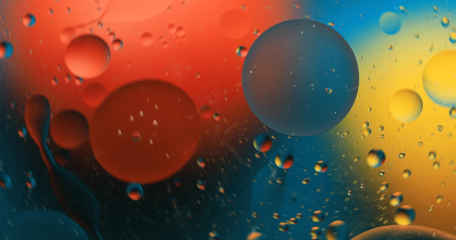 Abstract colorful background. Drops of oil in water. Rainbow colors | Shutterstock HD Video #1050504295