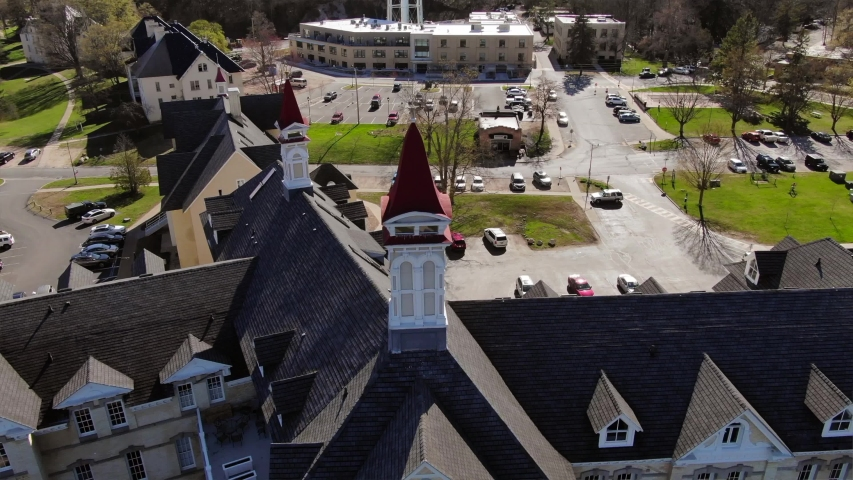 The Village in Traverse City Northern Michigan Lake Michigan Beautiful Scenery Old Hospital Event Area Shopping warm sunny day drone shot castle royalty wrap around shot