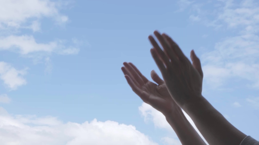 Applause. Woman hands applauding over blue sky background. Low angle view | Shutterstock HD Video #1050522751