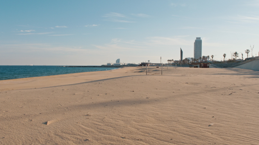 4K Completely deserted beach in Barcelona under lockdown measures to tackle coronavirus pandemic  | Shutterstock HD Video #1050534052