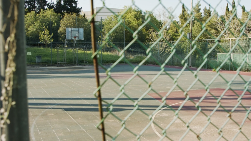 Abandoned and neglected basketball court due to corona virus outbreak Royalty-Free Stock Footage #1050564589