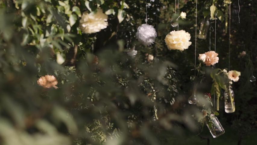 Wedding decor, pastel flowers in garden ceremony on green background   Shutterstock HD Video #1050576142