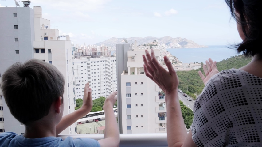 Family hands applauding medical staff from balcony. People clapping on balconies and windows in support of health workers, doctors and nurses during the Coronavirus pandemic | Shutterstock HD Video #1050577852