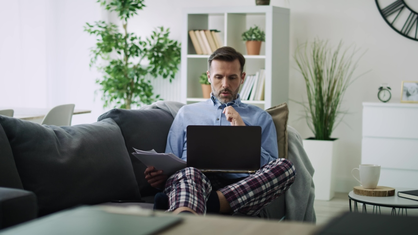 Panoramic video of a man working at home. Shot with RED helium camera in 8K. | Shutterstock HD Video #1050579676