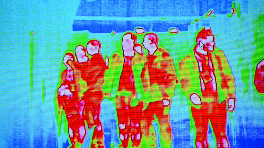 Corona virus thermal imaging unit aka infrared temperature control monitor under processing, influenza coronavirus infected people detection in airport, health care diversity | Shutterstock HD Video #1050603472