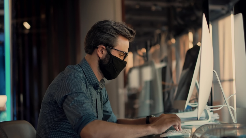 Man In Face Mask Office Workplace On Coronavirus Epidemic.Remote Chatting Colleague Internet Online Meeting Conference Webinar.Distance Work Webcam.Businessman In Face Mask On Coronavirus Health Care. | Shutterstock HD Video #1050611338