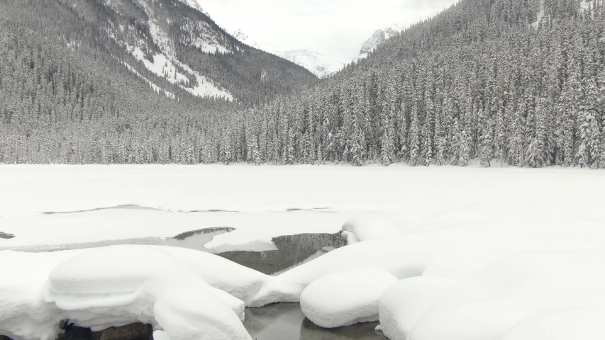 Beautiful Canadian Mountain Landscape View of White Puffy Snow Covered Joffre Lake during a vibrant winter day. Located near Pemberton, North of Vancouver, BC, Canada. | Shutterstock HD Video #1050615226