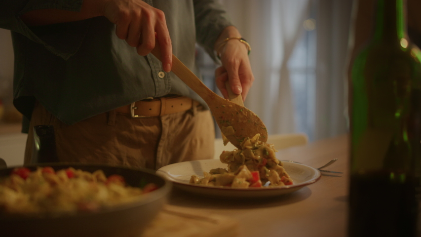 Person Serving Delicious Looking Pasta on the Plate. Serving Profesionally Cooked Pasta Dish in the Restaurant or for Romantic Dinner Meal at Home. Close-up Slow Motion Camera Shot Royalty-Free Stock Footage #1050644782