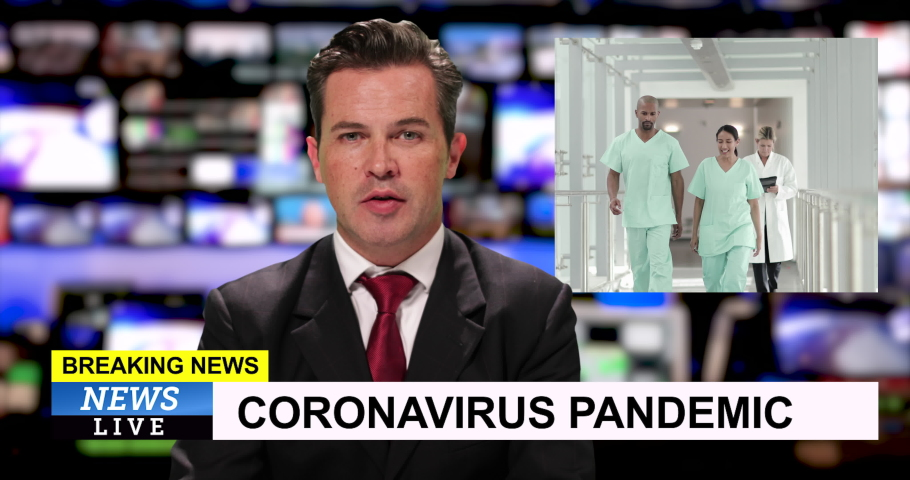 MS male television anchor at news desk presenting breaking news during Coronavirus Pandemic