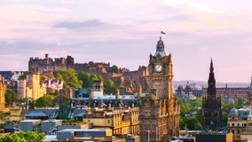 Edinburgh, UK. Aerial view of Edinburgh, Scotland. The city with Castle and Clock Tower during the evening. Cloudy sunset sky. Time-lapse at sunset, panning video