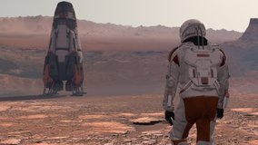 Astronaut wearing space suit walking on the surface of mars. Exploring mission to mars. Futuristic colonization and space exploration concept. 3d rendering. Elements of this video furnished by NASA.
