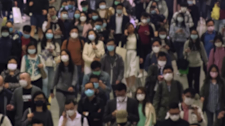 Slow motion of unrecognized people wearing medical face masks at metro in Hong Kong. Coronavirus concept Royalty-Free Stock Footage #1050689809