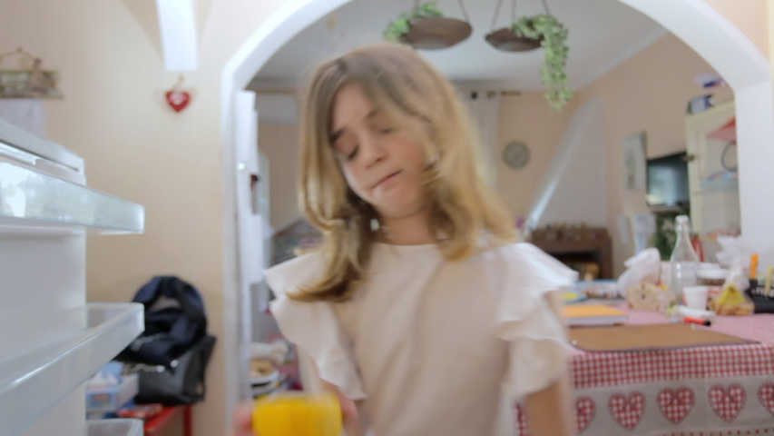 A cute little girl opening the fridge and getting sad because it's completely empty, except for one half of a lemon. Point-of-view: camera inside the refrigerator.