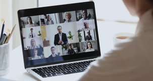 Business woman remote worker video conferencing boss and colleagues by online call, employees team chat working from home office. Group videocall discussion concept. Over shoulder laptop screen view