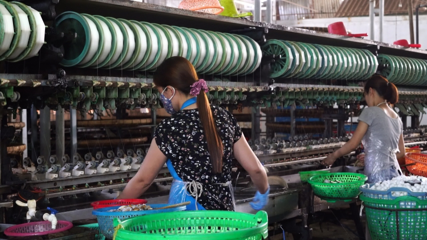 Dalat, Vietnam - march 18, 2020 : Silk farm, clothes produce from silkworm insects cocoon, textile factory. Factory for production of silk threads near Da Lat, Vietnam