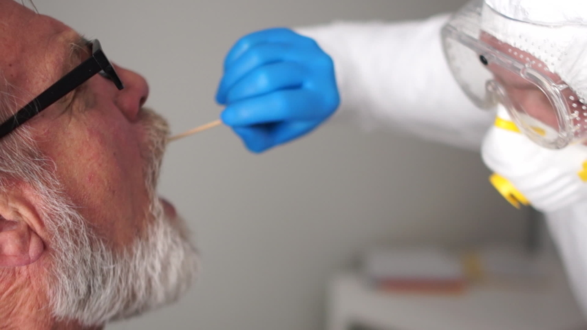 Close up portrait of a doctor in a protective suit takes a swab from the throat of an elderly senior man pensioner. Non-invasive diagnostic method by PCR reaction. Rapid test covid 19, SARS-CoV-2, IgM Royalty-Free Stock Footage #1050710326