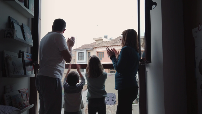April 08, 2020. Valencia, Spain . United family clapping in the window in support of doctors and police against coronavirus