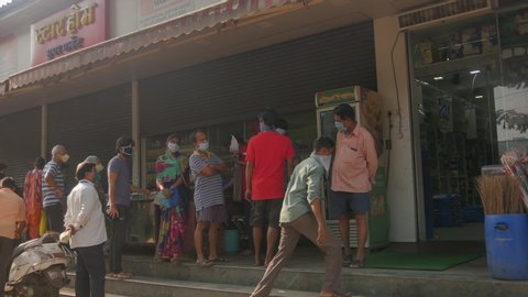 Mumbai Maharashtra india  April 15 th 2020, western suburbs of Mumbai city , people are standing  in the queue to get the grocery in the morning time wearing mask  in lockdown time  in india.