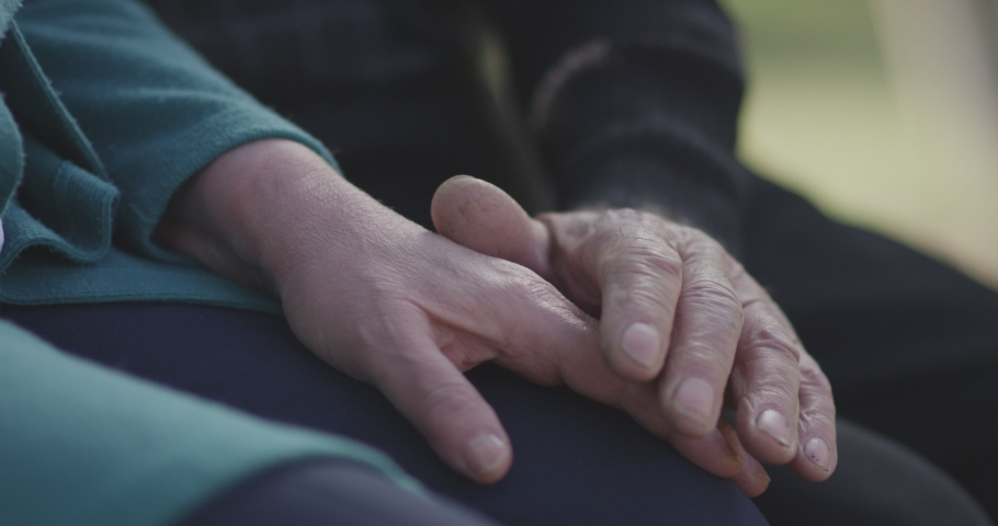 4K Faithful old couple holding hands. Close-up of hands of lovely aged couple caring and loving each other. Support trust in marriage relationship. Beautiful footage. Health care concept. Slow Motion. | Shutterstock HD Video #1050758128