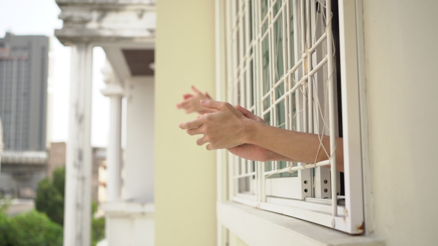 Clapping hands at balcony to show gratitude to health care worker | Shutterstock HD Video #1050774490