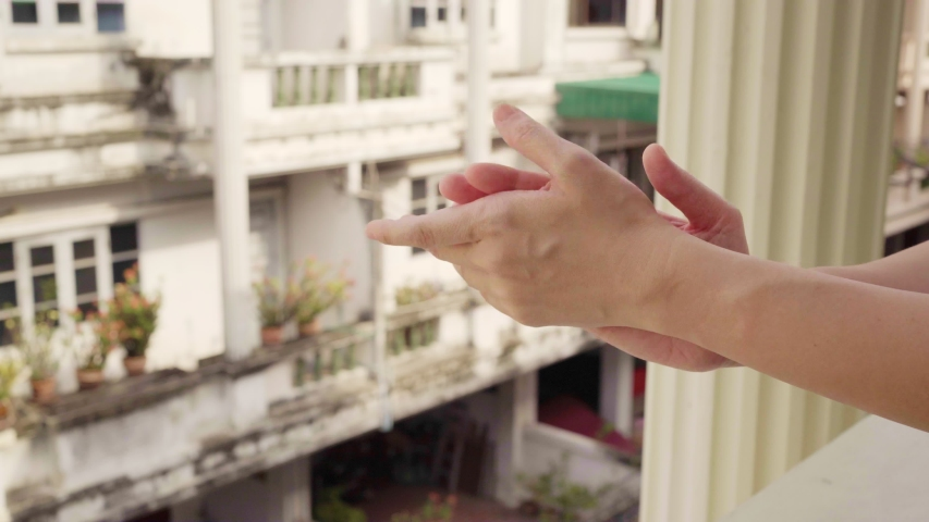 Clapping hands at balcony to show gratitude to health care worker | Shutterstock HD Video #1050774502