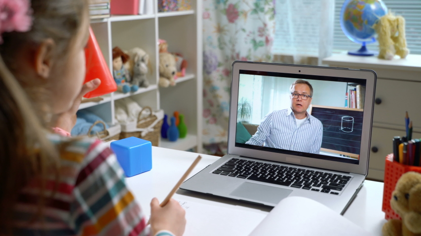 Middle-aged man distance teacher online tutor conferencing on laptop communicate with pupil by webcam video call e-learning. Home quarantine distance learning and working at home.