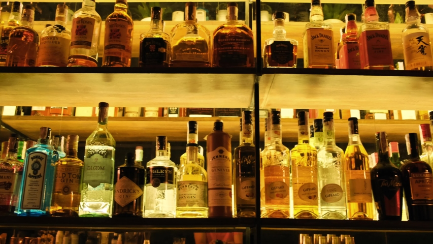 Kyiv, Ukraine - March, 2020: Luxury liquors collection in a pub, bar, club or restaurant. Alcohol bottles on the shelves inside the bar room area. Vodka, Gin, Whisky, Brandy, Rum 4k