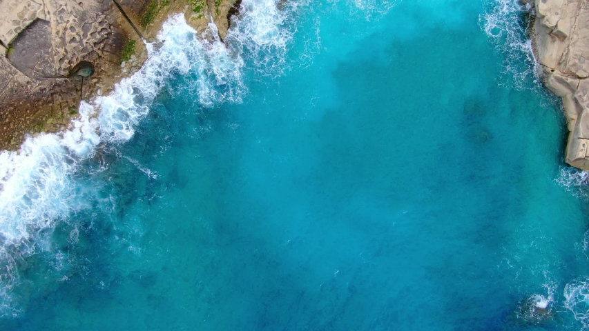 Wild Ocean water from above - Waves hitting the rocks - aerial photography | Shutterstock HD Video #1050852382
