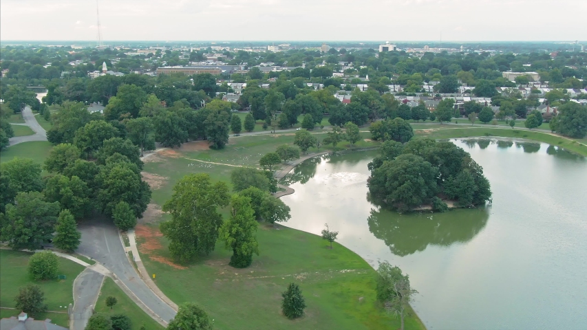 Aerial: William Byrd Park, Swan Lake and residential houses. Richmond, Virginia  | Shutterstock HD Video #1050916960