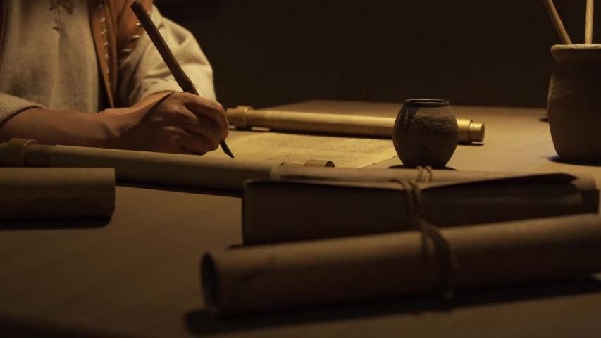 Closeup of writing a letter on ancient paper, ancient scrolls Royalty-Free Stock Footage #1050993478