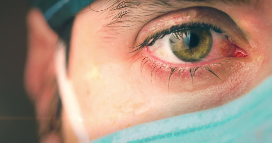 Eyes of a doctor or nurse as she cries after a grueling shift to treating Coronavirus patients in the intensive care unit. Royalty-Free Stock Footage #1050996706