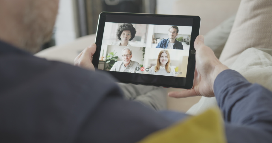 Video call with colleagues working from home on sofa with ipad, Business people video conference virtual meeting online wireless technology | Shutterstock HD Video #1051023742