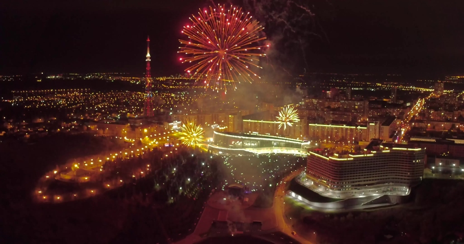 Fireworks over the city shot with quadrocopter. the day of the city. holiday