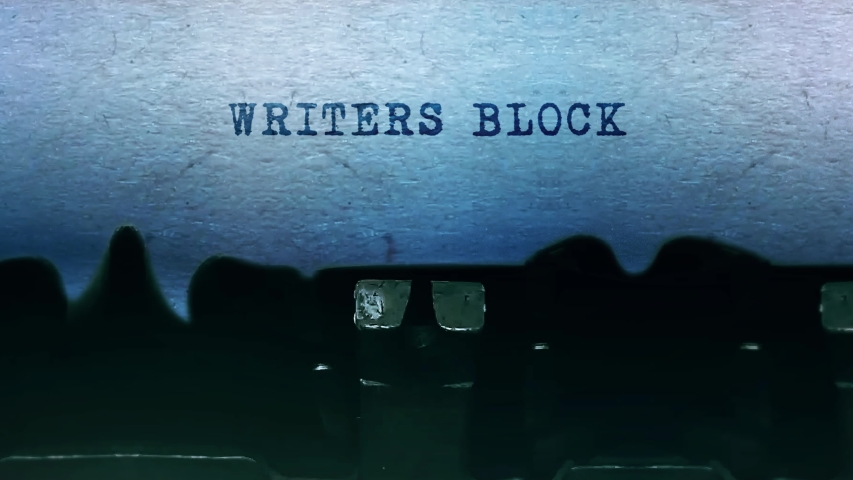 Writers Block Word closeup Being Typing and Centered on a Sheet of paper on old vintage Typewriter mechanical 4k Footage Background Animation. | Shutterstock HD Video #1051058059