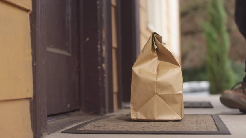 No contact home food delivery order left on a doorstep for the customer to pick up Royalty-Free Stock Footage #1051094023