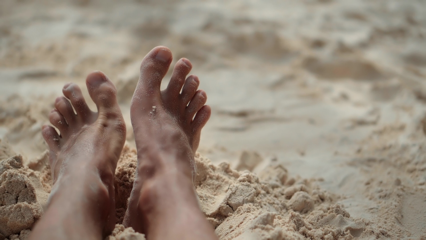 Man Lying On Beach And Moving Legs On Holiday Vacation.Legs Man On Beach Sun Lounger Sandy Shore Sunbathing.Tan Guy Relaxing Sandy Beach In Sunbed On Caribbean Exotic Resort.Happy Healthy Tourist Rest | Shutterstock HD Video #1051119466