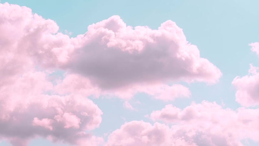 Motions clouds. Puffy fluffy beautiful pink clouds on turquise sky time lapse. Slow moving clouds. Pastel palette. Wonderful nature Royalty-Free Stock Footage #1051122679
