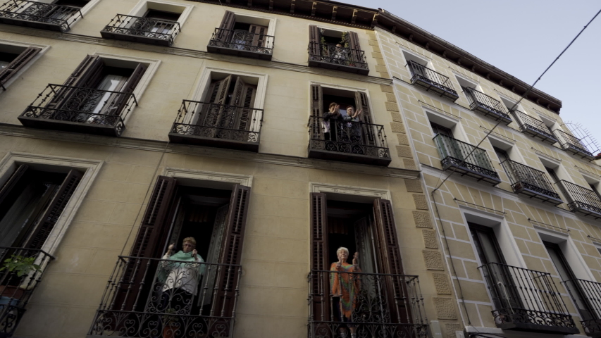 MADRID, SPAIN - APRIL 8TH 2020. Neighbors of Madrid central district applaud from their balconies to thank medical workers who are fighting coronavirus