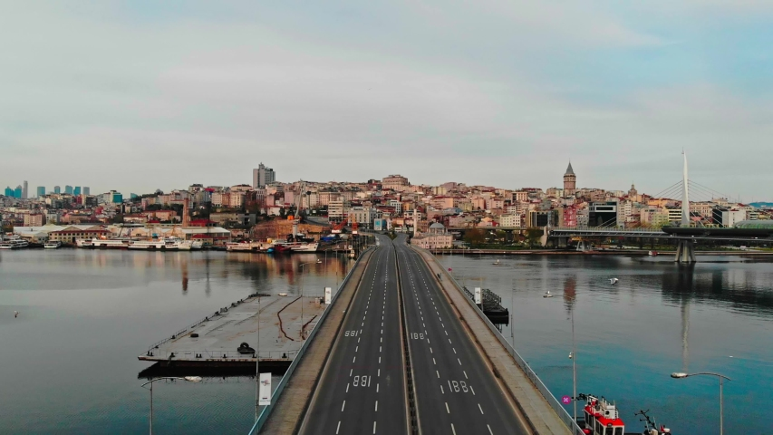 Empty unkapani ataturk bridge. Istanbul lockdown empty roads due coronavirus. Old town  galata tower view no cars drone shot.