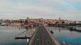 Empty unkapani ataturk bridge. Istanbul lockdown empty roads due coronavirus. Old town  galata tower view no cars drone shot.