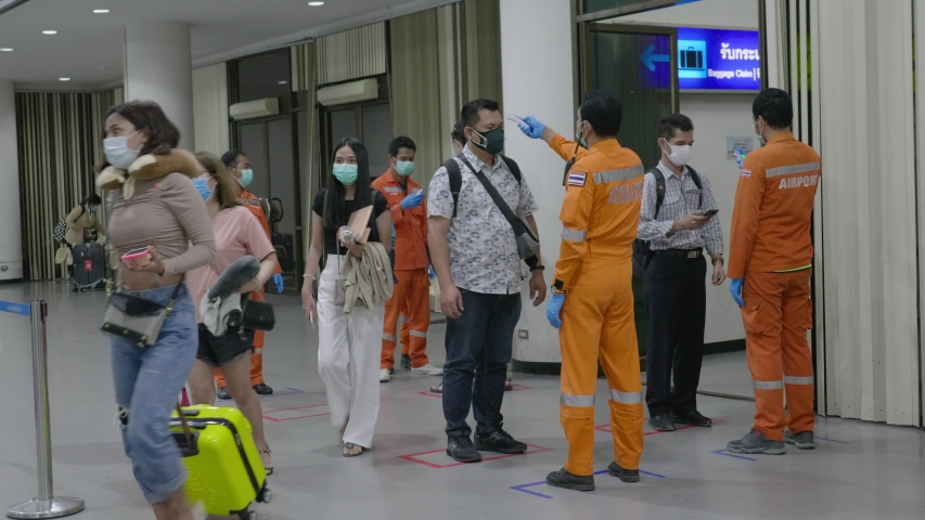 Bangkok, Thailand March 1 2020 Airport Security Workers Thermal Scanning Plane Passengers for Covid-19 Coronavirus Transportation Safety