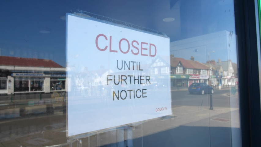Slow motion shot of independent shop closed until further notice due to the COVID 19 coronavirus pandemic, bars, cafes, restaurants, clubs all shut cause of this international crisis Royalty-Free Stock Footage #1051171039