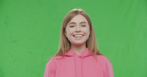 Happy smiling young pretty woman Isolated on Green Screen, Chroma Key. 4k raw video footage slow motion 60 fps