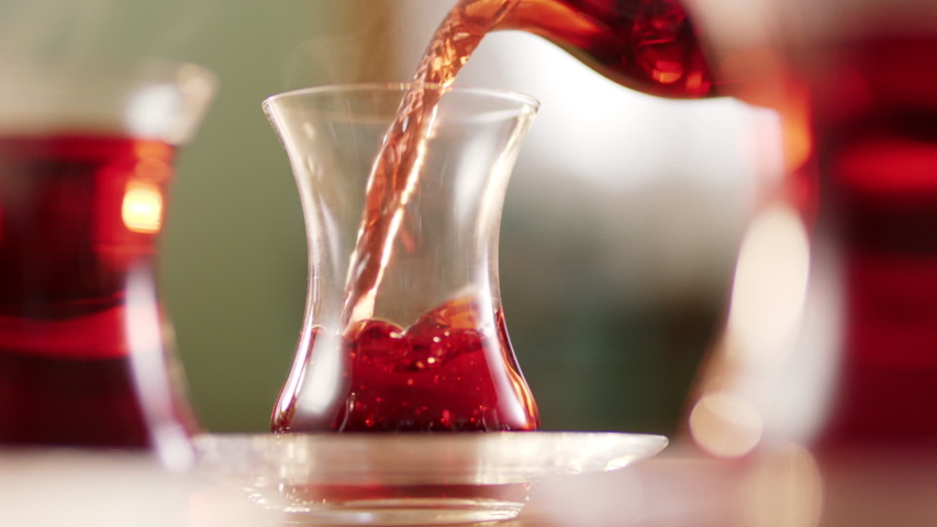 Slow motion.It fills Turkish tea into a glass special to the Turks.