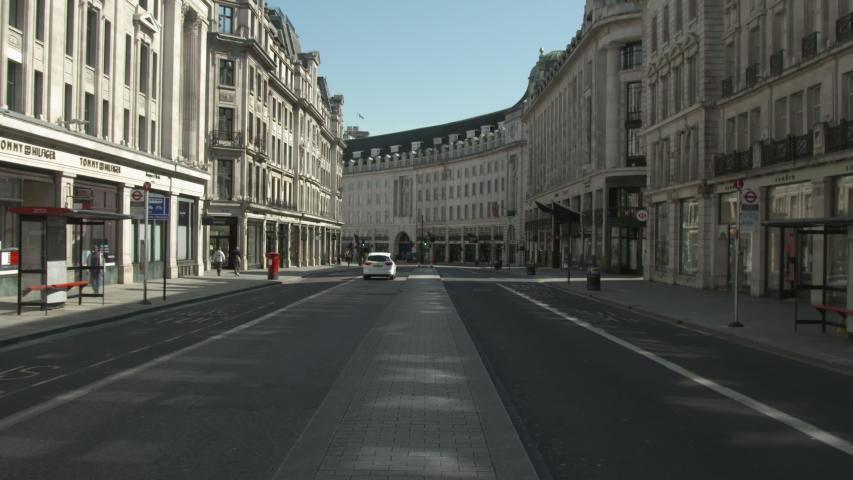 London, UK - April 21 2020: Coronavirus Outbreak lockdown - Regent Street deserted | Shutterstock HD Video #1051195975