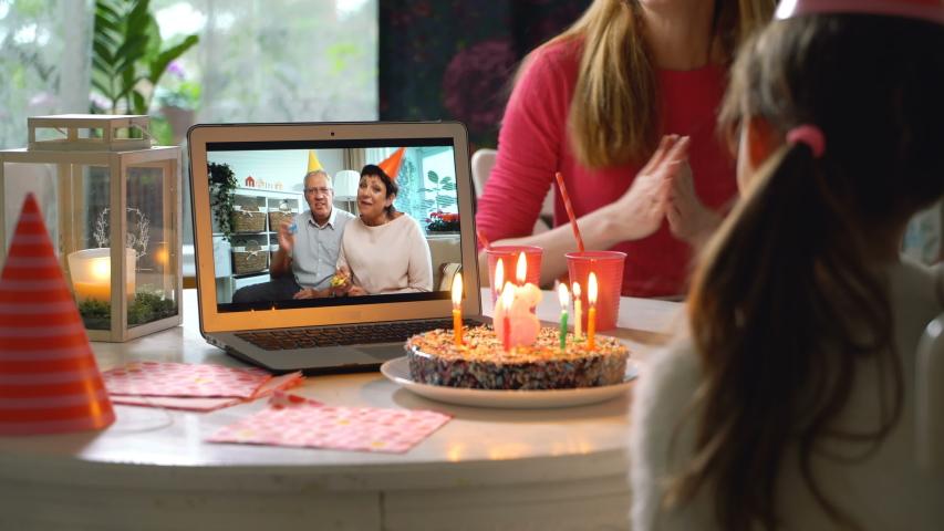 Happy Grandpa and Grandma Congratulate their Grandchildren Happy Birthday Using Laptop Video Call. Social distancing, self isolation during quarantine